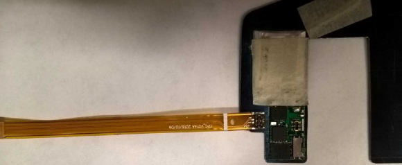 A data transfer wand inserted into a deep-insert skimmer.