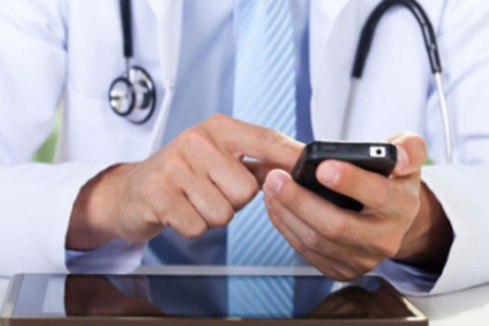 Apple's iOS push could change healthcare data sharing, still won't kill the fax